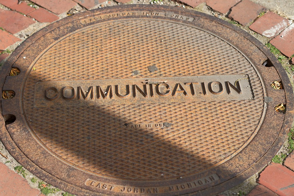 "Manhole cover that reads ""Communication"""