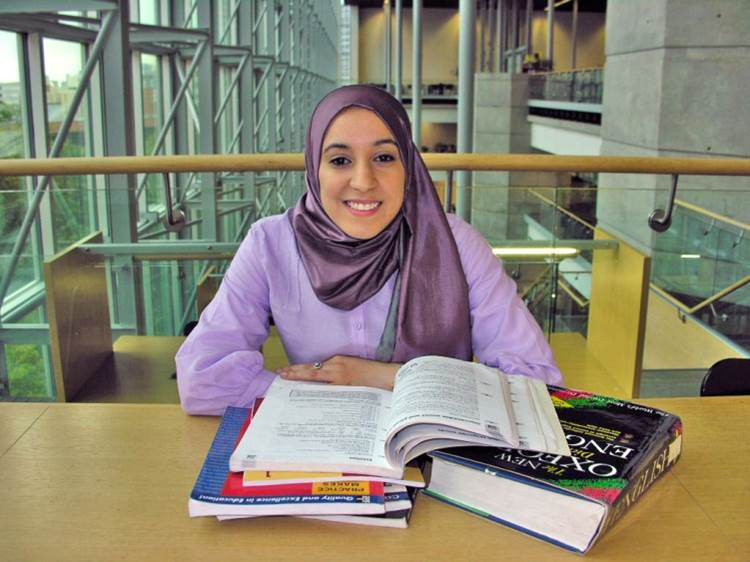 adult newcomer reading in Winnipeg Public Library's EAL collection