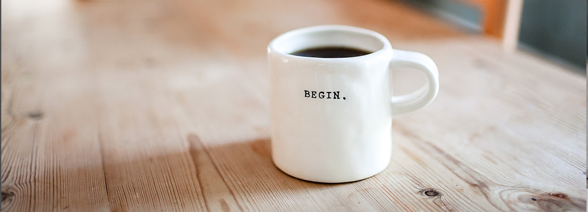 mug with 'begin' typed on it