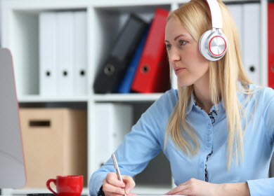 woman using laptop with headphones