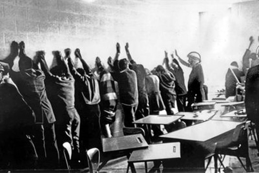 Members of the Montreal riot squad prepare to frisk and question several of the 100 students involved in the occupation of the cafeteria and computer centre at Sir George Williams University, in Montreal, in a Feb. 11, 1969, file photo. (The Globe & Mail, 2019)