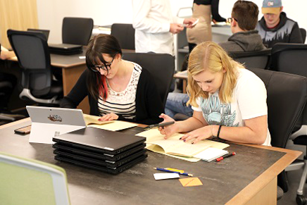 Students review records in the Archives and Special Collections Reading Room