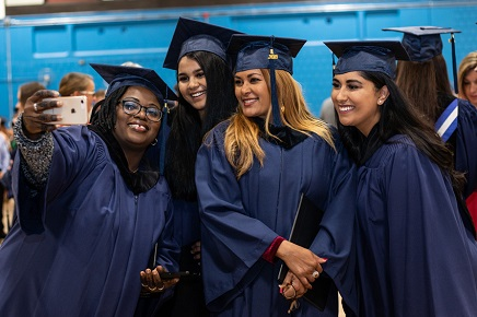 MRU graduates pose to take a photo at convocation