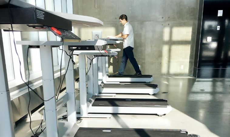 Student on treadmill desk