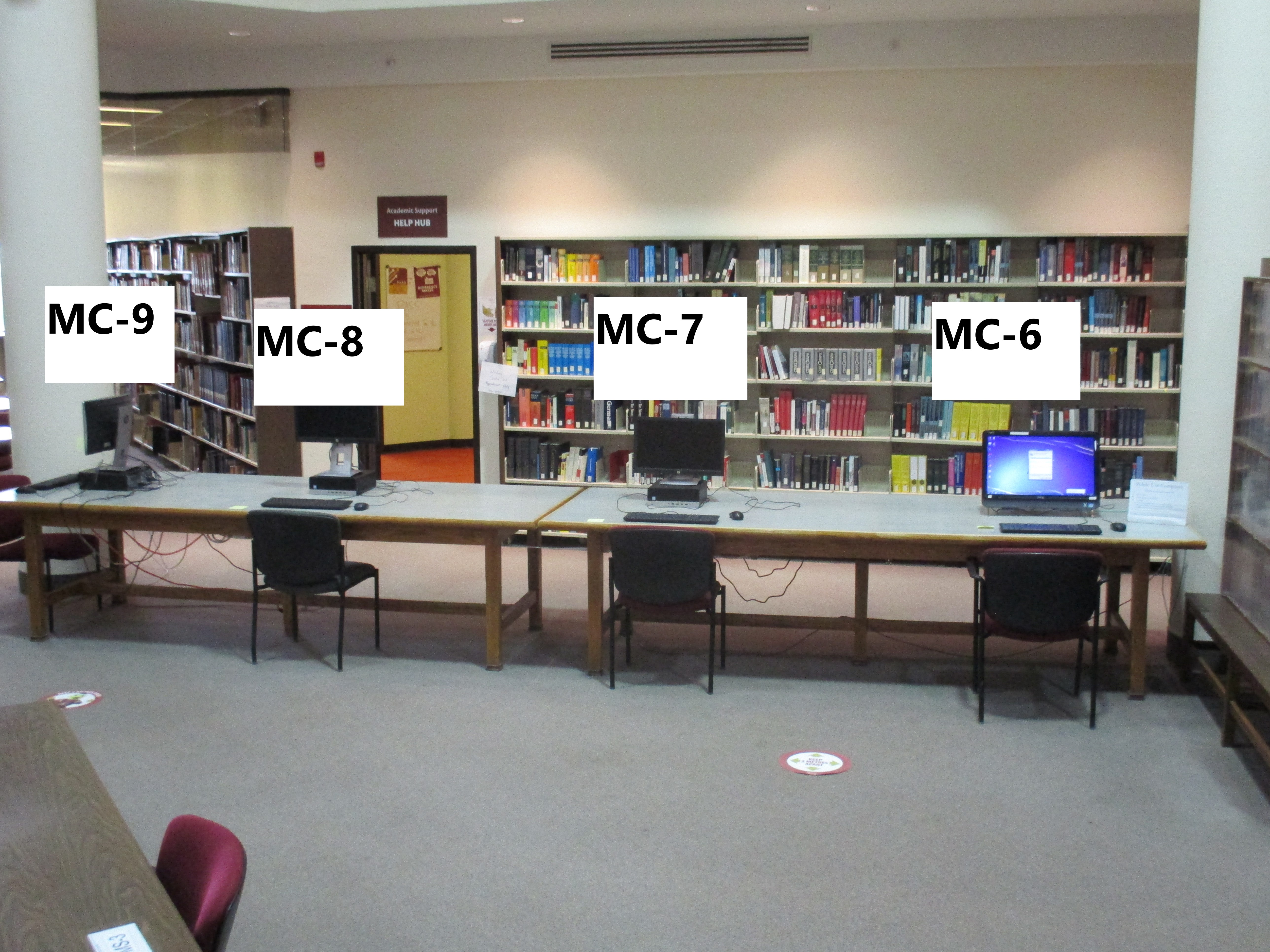 Photos of computers with numbered seats