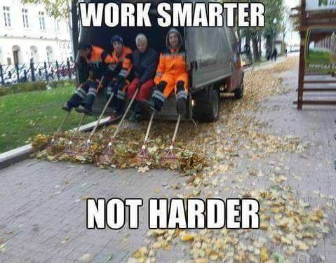 image using a truck to rake leaves