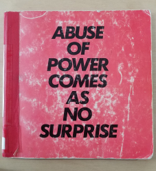 "The red cover of Jenny Holzer's ""Truisms and Essays."" Large, bold all-caps black text across the entire cover states ""abuse of power comes as no suprise."""