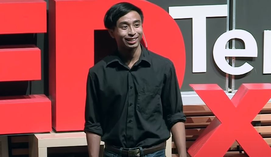 Image of Viet Vu from the video a handsome young man wearing a denim shirt and jeans