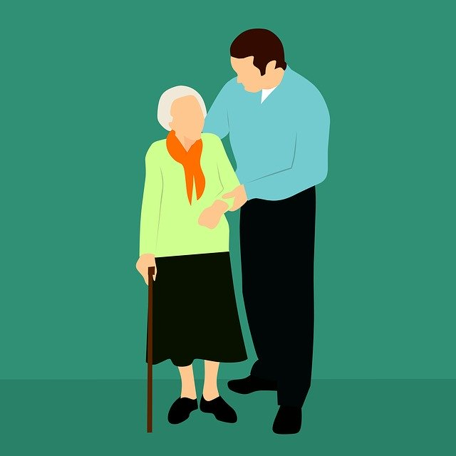 man helping older woman with cane