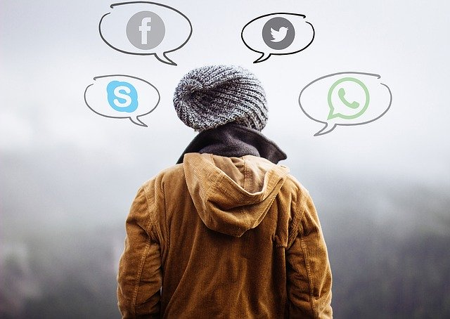 back of child with social media bubbles around his head